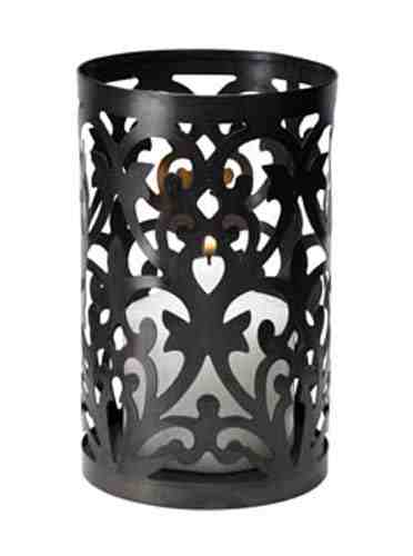 - Candle holder for pillar style candles - Crafted from sturdy wrought iron - Measures 4.5 Inch wide x 6.5 Inch tall - Designed for 3-inch diameter candles
